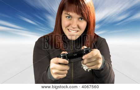 Cute Redhead Playing Video Games In Winter