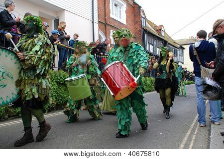 HASTINGS, ENGLAND - MAY 7: Drummers perform during a parade through the Old Town at the Jack In The Green festival on May 7, 2012 in Hastings, East Sussex. The event marks the May Day bank holiday.