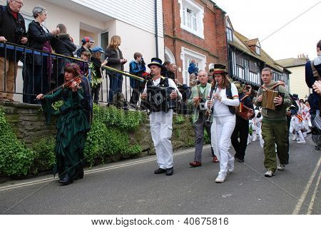 HASTINGS, ENGLAND - MAY 7: Musicians perform during a parade through the Old Town at the Jack In The Green festival on May 7, 2012 in Hastings, East Sussex. The event marks the May Day bank holiday.