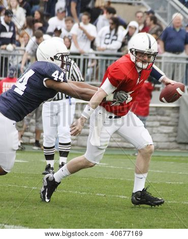Penn State quarterback Matthew McGloin drops back to pass