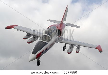 Aircraft In Clouded Sky