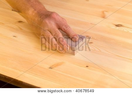 Mans Hand On Sanding Block On Pine Wood