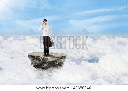 Businessman On The Phone Above Clouds