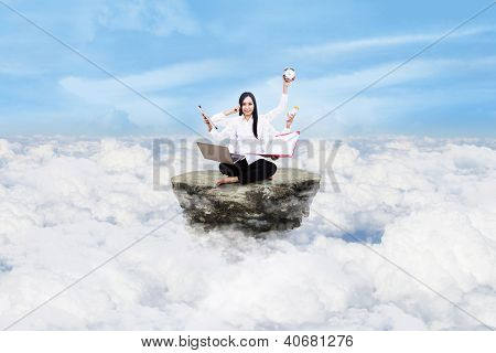 Entrepreneur Multitasking Above Clouds