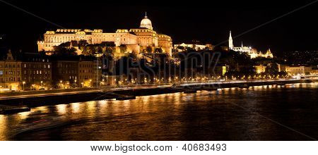 Buda Castle and Fisherman's Bastion by Danube river at night. Budapest, Hungary