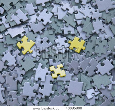 jigsaw puzzle with three yellow tiles