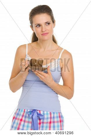 Thoughtful Young Woman In Pajamas After Sleep With Cup Of Coffee