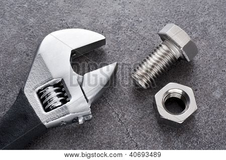 monkey wrench and bolt and nut