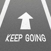 Asphalt Road Background With Signal Arrow And Word Keep Going