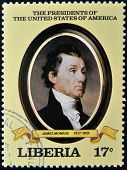 A stamp printed in Liberia shows President James Monroe circa 1982
