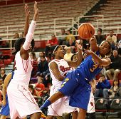 JAMAICA, NY-JAN 2: Delaware Blue Hens guard Jaquetta May (3) passes the ball around St. John's Red S