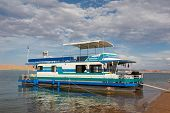 stock photo of houseboats  - Houseboat on scenic Lake Powell located in Southern Utah - JPG
