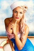 stock photo of life-boat  - Combined Illustration And Photograph Of A Sexy Navy Sailor Pin Up Girl Thinking On Starboard Side Of A Sailing Boat - JPG