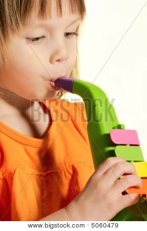 Little Beauty Girl With Toy Saxophone