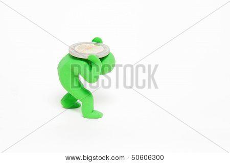 green plasticine puppet bears a heavy coin