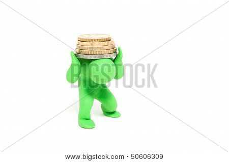 small green plasticine puppet bears stack of coins