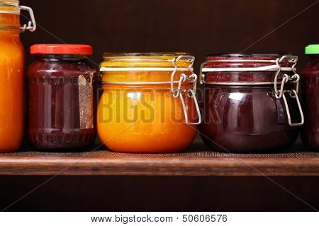 Jars of jam on a shelfof Jam