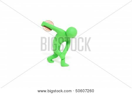 small green plasticine puppet throws euro cent