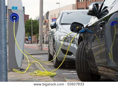 Electric Cars At Charging Station