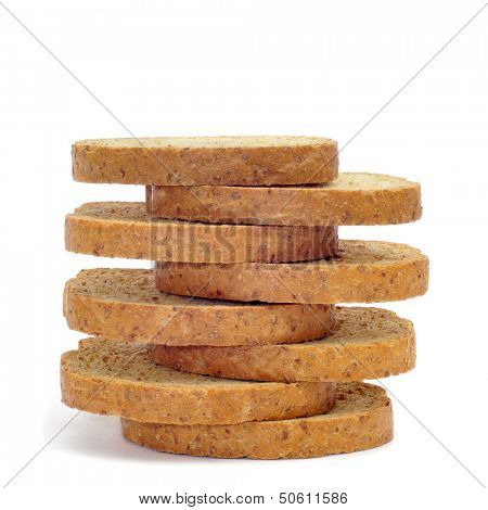 a pile of whole wheat rusks on a white background