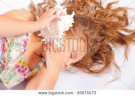 Sleeping Little Girl With Seashell