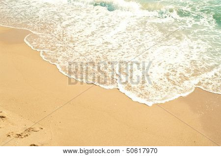 Waves Of Sea And Yellow Sand