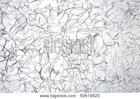 Abstract pattern obtained by crumpling of gray shiny material