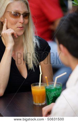 Couple having a drink on a terrace