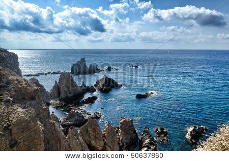Sirens reef at Cabo de Gata, Spain. Seascape with reef and clouds