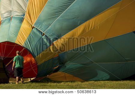 Man Inflating A Hot-air Balloon With A Burner