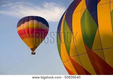 Airborne Hot-air Balloon With Another In Foreground