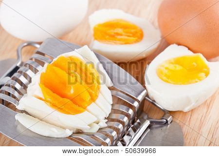 Egg Cutter And Cutted Eggs On Table