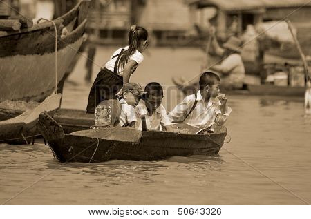 Unidentified children go to school on boat