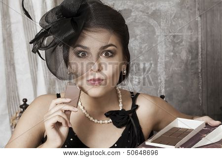 Pretty Female Eating A Chocolate