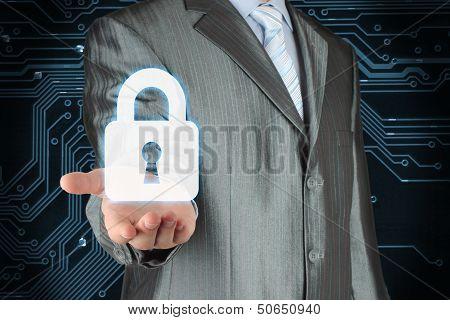 Businessman with lock on dark circuit board background