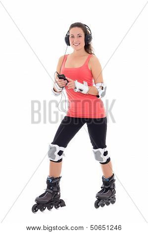 Attractive Woman In Roller Skates Listening Music On White Background