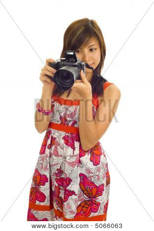 Asian Woman With A Digital Camera