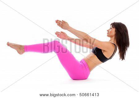 Pretty Woman In Yoga Pose - Boat Pose Position.