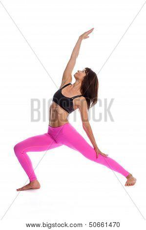 Pretty Woman In Yoga Pose - Reverse Warrior Position.