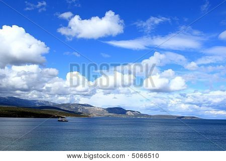 Fishing Boat Under The Blue Sky