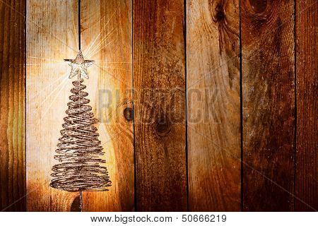 Christmas Greeting Card With Gold Metal Firtree On The Wooden Background