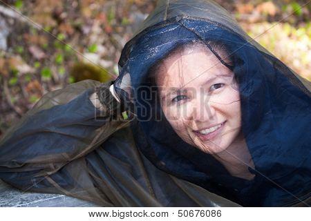 Young Woman Wears Bug Hood