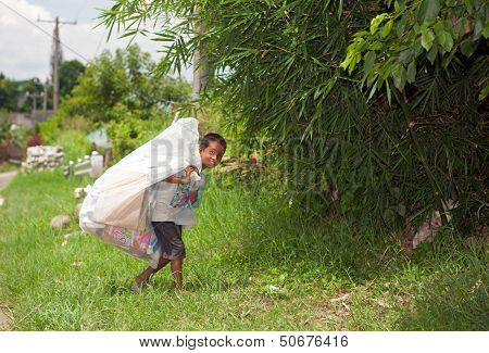 Boy Collecting Trash Bag