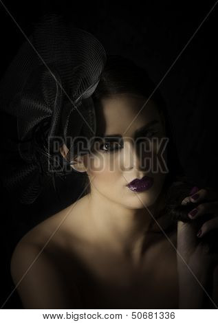 Glamorous woman in dramatic makeup