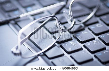 Glasses On A Keyboard