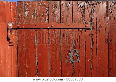 Hinge and number on wooden gate