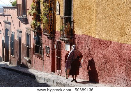 Mexican lady walking downhill