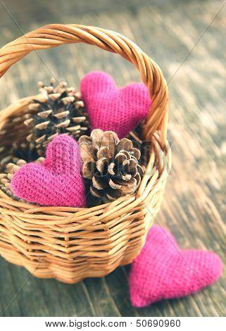 Pine Cones And Handmade Crochet Hearts In Basket