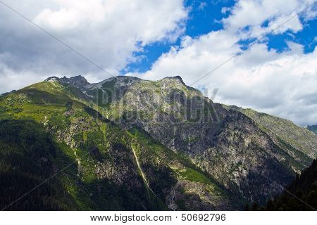Mountain peaks in Dombai. Summer in cloudy weather
