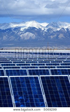 Solar Panel Rows With Mountains